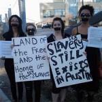 women protest sex slavery in Austin